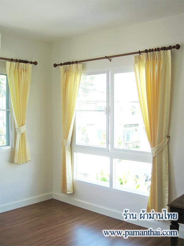 ผ้าม่านสีอ่อนช่วยให้ห้องดูกว้างขึ้น